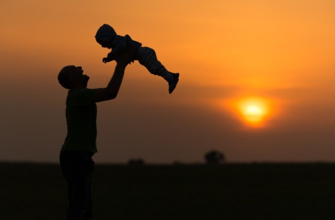 Father throwing baby